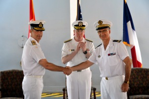 Vice Admiral John Miller Commander Maritime Forces applauds the CoC ceremony as Commodore Brian Santarpia Royal Canadian Navy and René-Jean Crignola of the French Navy