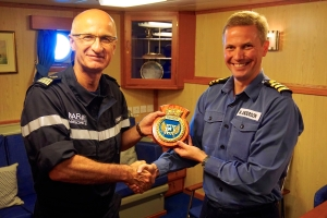 Commander of CTF150, Capt. Crignola meets HMS Richmond Commanding Officer, Cdr. Anderson, onboard the British ship.