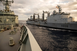 FS Var and HMAS Newcastle side by side, preparing for a replenishment at sea.