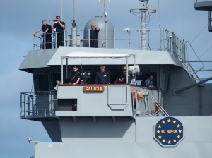 Crew members from the flagship, Spanish ship Galicia, monitoring replenishment at sea from the vessel's bridge.