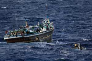 Members of HMAS Newcastle's boarding party prepare to board and search a dhow on 19 June 2015, which revealed 581 Kgs of hidden illegal narcotics