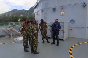 LSCS Mulligan demonstrates Boarding Team weapons to a Seychelles Coast Guard Boarding Team