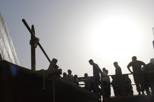 HMAS Crew boarding the dhow