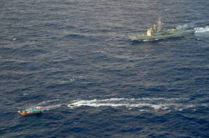 HMAS Newcastle tracks a dhow on 03 July 2014 off the East Coast of Africa and from which it siezed 138 kg of heroin worth an estimated street value of around $108 million.  *** Local Caption *** HMAS Newcastle is deployed in the Middle East Region on Operation MANITOU, Australia's contribution to the US-led Combined Maritime Forces (CMF). The CMF undertakes patrols in the broader northwest Indian Ocean to both combat piracy and to intercept the trafficking of drugs that help fund international terrorism. The CMF also encourages regional cooperation to create a safer maritime environment. HMAS Newcastle is on her fifth deployment to the Middle East Region as is the 60th rotation of a RAN vessel since the first Gulf War in 1990.