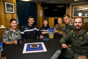 Officers from the French Frigate, FS Sarcouf, are entertained by members of HMAS Newcastle's Wardroom from left; Executive Officer, Lieutenant Commander Anita Nemarich, Lieutenant (LEUT) Jeremy Baumgarten and LEUT Daile Coey-Braddon as part of a crew exchange visit between the two ships in the Gulf of Oman. HMAS Newcastle is tasked to carry out maritime security patrols in the Indian Ocean in support of Operation MANITOU. *** Local Caption *** HMAS Newcastle is deployed in the Middle East Region on Operation MANITOU, Australia's contribution to the US-led Combined Maritime Forces (CMF). The CMF undertakes patrols in the broader northwest Indian Ocean to both combat piracy and to intercept the trafficking of drugs that help fund international terrorism. The CMF also encourages regional cooperation to create a safer maritime environment. HMAS Newcastle is on her fifth deployment to the Middle East Region as is the 60th rotation of a RAN vessel since the first Gulf War in 1990.