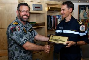 Commanding Officer HMAS Newcastle, Commander Dominic MacNamara, RAN, presents the ship's plaque to Commanding Officer of the FS Sarcouf, Commander Guillaume Garnoix (left), as part of a visit to the French Frigate in the Gulf of Oman. HMAS Newcastle is tasked to carry out maritime security patrols in the Indian Ocean in support of Operation MANITOU. *** Local Caption *** HMAS Newcastle is deployed in the Middle East Region on Operation MANITOU, Australia's contribution to the US-led Combined Maritime Forces (CMF). The CMF undertakes patrols in the broader northwest Indian Ocean to both combat piracy and to intercept the trafficking of drugs that help fund international terrorism. The CMF also encourages regional cooperation to create a safer maritime environment. HMAS Newcastle is on her fifth deployment to the Middle East Region as is the 60th rotation of a RAN vessel since the first Gulf War in 1990.