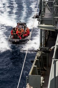 Personnel from the French Frigate, FS Sarcouf, come alongside HMAS Newcastle as part of a crew exchange visit between the two ships in the Gulf of Oman. HMAS Newcastle is tasked to carry out maritime security patrols in the Indian Ocean in support of Operation MANITOU. *** Local Caption *** HMAS Newcastle is deployed in the Middle East Region on Operation MANITOU, Australia's contribution to the US-led Combined Maritime Forces (CMF). The CMF undertakes patrols in the broader northwest Indian Ocean to both combat piracy and to intercept the trafficking of drugs that help fund international terrorism. The CMF also encourages regional cooperation to create a safer maritime environment. HMAS Newcastle is on her fifth deployment to the Middle East Region as is the 60th rotation of a RAN vessel since the first Gulf War in 1990.