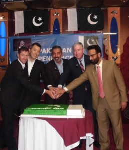 Pakistan 68th Independence Day celebration – cutting the cake. L-R - Commodore William Warrender, Rear Admiral Hiroshi Ito, Rear Admiral Moazzam Ilyas, Vice Admiral John Miller, and Mr Mohammed Ahad, Head of Chancery, Pakistan Embassy.
