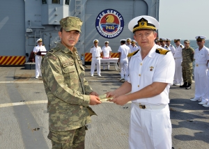 CTF 151Chief of Staff Captain Ilker Ozkan congratulating Amphibious Team Commander LTJG. Onur Karaman on his promotion.