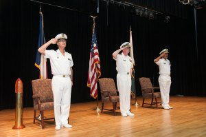 CTF150 Change of Command ceremony. Captain Crignola FN, Vice Admiral Miller USN, and Rear Admiral Muhammad Moazzam Ilyas PN saluting the National Anthems.