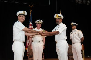 Captain Crignola FN hands over the command of CTF150 to Rear Admiral Muhammad Moazzam Ilyas PN as Vice Admiral Miller USN looks on.