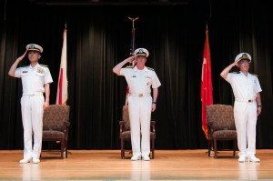 Rear Admiral Ito JMSDF, Vice Admiral Miller USN and Captain Ayhan Bay TN stand to attention as the National athems are played at the beginning of the CTF151 CoC ceremony.