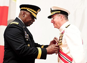 150903-N-SI600-269 MANAMA, Bahrain (Sept. 3, 2015) U.S. Army General Lloyd J. Austin III, Commander, U.S. Central Command, awards Vice Adm. John W. Miller, outgoing commander of U.S. Naval Force Central Command/U.S. 5th Fleet/Combined Maritime Forces (NAVCENT/C5F/CMF), the Distinguished Service Medal during the NAVCENT/C5F/CMF change-of-command ceremony held aboard USS Theodore Roosevelt (CVN 71), in port here. Vice Adm. Kevin M. Donegan relieved Miller as commander of NAVCENT/C5F/CMF. (U.S. Navy photo by Mass Communication Specialist 3rd Class Anthony Hopkins/Released)