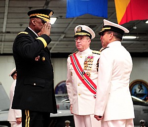 150903-N-SI600-326 MANAMA, Bahrain (Sept. 3, 2015) U.S. Army General Lloyd J. Austin III, Commander, U.S. Central Command (left), returns a salute from Vice Adm. Kevin M. Donegan (right), as Donegan assumes command of U.S. Naval Force Central Command/U.S. 5th Fleet/Combined Maritime Forces (NAVCENT/C5F/CMF) during a change-of-command ceremony held aboard USS Theodore Roosevelt (CVN 71) in port here. Donegan relieved Vice Adm. John W. Miller as commander of NAVCENT/C5F/CMF. (U.S. Navy photo by Mass Communication Specialist 3rd Class Anthony Hopkins/Released)