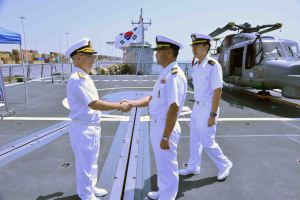 Captain Yoo and his interpreter, Ensign Choi, welcome Rear Admiral Bay.