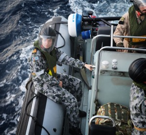 HMAS Melbourne's Medical Officer, Lieutenant Tenille Chapman waits in the seaboat while the Boarding Team embarks. They are heading to provide aid to a critically ill mariner on board the merchant vessel City of Beijing.