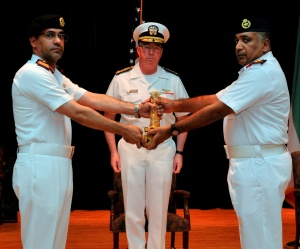 Captain Suliman Al-Enazi Royal Saudi Naval Force transfers command to Colonel Mohammad Aleid, Kuwait Naval Force with Vice Admiral John W Miller, Commander Combined Maritime Forces.