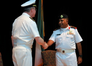 Colonel Mohammad Aleid, Kuwait Naval Force being congratulated by Vice Admiral John W Miller on taking command of CTF151.