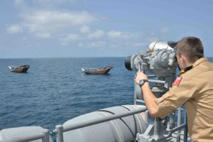 CTF 151's Ensign Muhammet Bostan observes fishing dhows