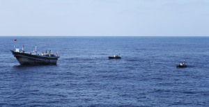 HMAS Melbourne's sea boats keep a watch over a dhow found to be smuggling 427kg of heroin across the Indian Ocean.