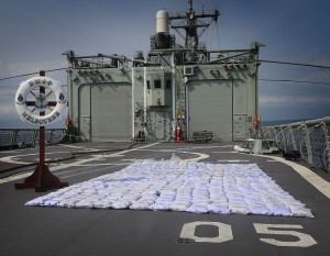 Seized illegal narcotics are seen on HMAS Melbourne's flight deck prior to disposal. About 427 kilograms of heroin was confiscated from a dhow smuggling the illegal drugs across the Indian Ocean.