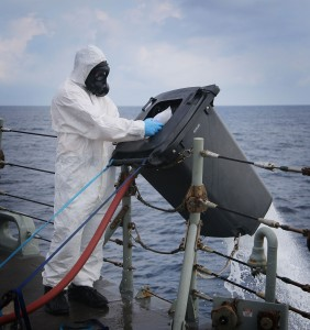 A HMAS Melbourne crew member disposes of illegal narcotics seized from a dhow in the Indian Ocean.