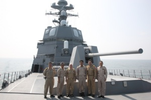 Commander CTF 151 Rear Admiral Ayhan Bay and the Japanese Counter Piracy Division Commander Captain Futoshi Toyozumi  together with CTF 151 staff and ship's officers onboard JS Akizuki .  Clockwise: LCDR (TUR N) Ozgur Ozkan, Capt. (JPN N) Futoshi Toyozumi,  Rear Admiral (TUR N) Ayhan Bay, CDR (JPN N) Yasuharu Aso,  LCDR (TUR N) Nazif Bozkurt and LCDR  (JPN N) Reo Tsuda