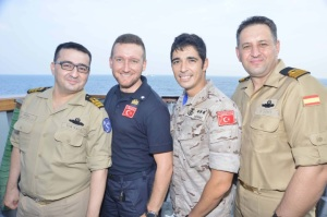 CTF 465 (EU Naval Force) and CTF 151 staff onboard TCG Gemlik.  Clockwise: LCDR (TUR N) Enis MULA,  LT (ITA N) Luca Giolo, Capt. (ESP MC) Ignacio Marquez and LCDR (TUR N) Nazif Bozkurt. 'Stronger Together'