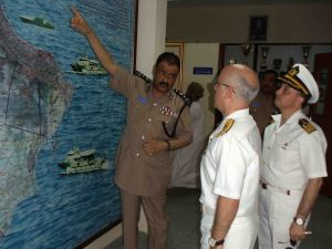 The Commander of the Omani Coast Guard, Brigadier General Bader Khalfan Al Zadgali, briefs Rear Admiral Bay.