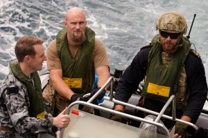 (L-R) Royal Australian Navy Lieutenant Liam Catterson, Boarding Party Officer, Special Agent Patrick Price of the United States Naval Criminal Investigative Service (NCIS) and Royal New Zealand Navy sailor Leading Seaman Combat Specialist Jack Walters prepare to board a fishing dhow suspected of illegal drug smuggling in the Arabian Sea.