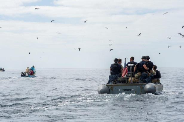8. USN Personnel approach local fishermen to understand what is happening in the area.