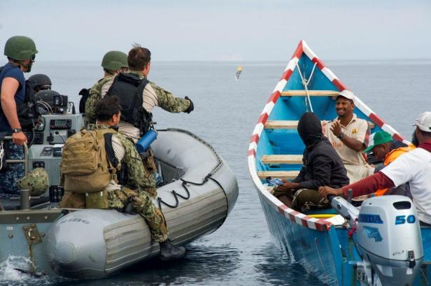 9.  USN Personnel interact with local fisherman of Mukalla to understand what is happening in the area