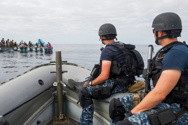 20. USN personnel as part of CTF 150 approach local fishermen.