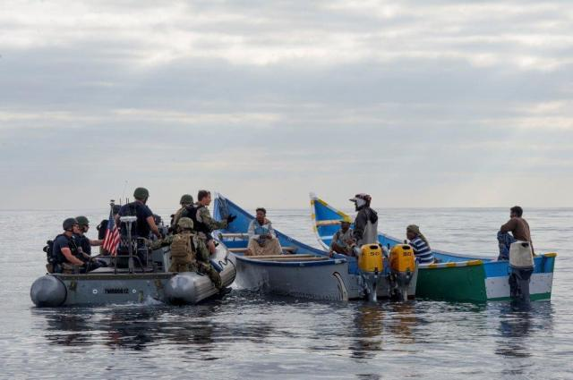 21. USN personnel discuss the local situation with fishermen of Mulkallah