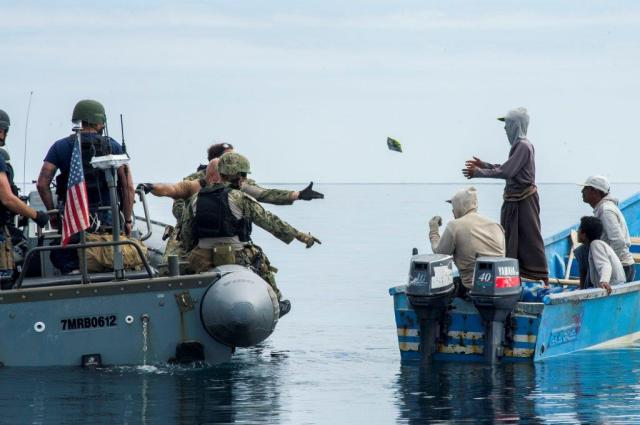 23. USN personnel discuss the local situation with fishermen of Mulkallah