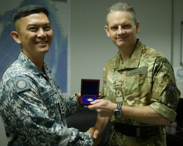 CCTF 151 Rear Admiral Ken Cheong presents CCTF 150, Commodore Guy Robinson a token coin at their first official meet up