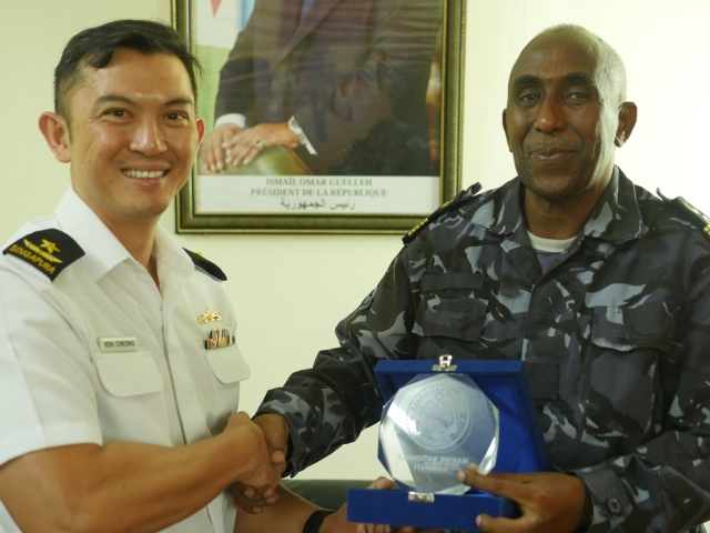 CCTF Rear Admiral Ken Cheong receives a token of appreciation from Head of Djibouti Navy, COL Abdourahman Aden Cher
