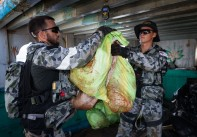 The narcotics are weighed by HMAS Arunta crew members.