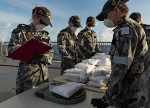 HMAS Arunta's sailors weigh illegal narcotics seized during their operation Manitou patrol in the Middle East region on 8 June 2017. *** Local Caption *** HMAS Arunta operates as part of the multi-national Combined Maritime Forces, predominately tasked to support Combined Task Force 150 for counter-terrorism and maritime security operations. Arunta is deployed on Operation MANITOU, supporting international efforts to promote maritime security, stability and prosperity in the Middle East region (MER). Arunta is on her third deployment to the MER and is the 64th rotation of a Royal Australian Navy vessel to the region since 1990.