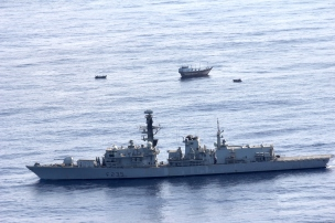HMS Monmouth with the suspect dhow in the background