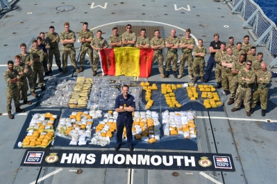 Royal Navy and Royal Marines Boarding Team, with Commanderdr Feasey (centre) and the recovered drugs.
