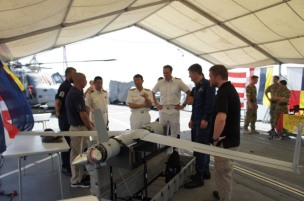 RADM Fukuda is given a brief on the capabilities of HMS Monmouth