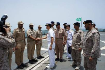 RADM Fukuda is welcomed by crew members of HMS Dammam a Saudi Destroyer