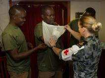 Petty Officer Medic Corina Burrows delivers a lesson in basic first aid to members of the Tanzanian Transnational Organised Crime Unit in HMAS Arunta while alongside in Dar Es Salaam, Tanzania.
