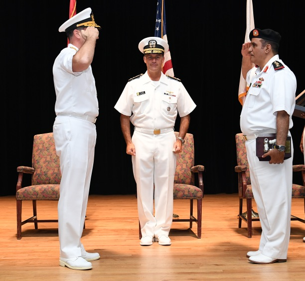 171102-N-XP344-070 MANAMA, Bahrain (Nov. 2, 2017) U.S. Navy Vice Adm. John Aquilino, commander of the Combined Maritime Forces, center, presides over the change of command ceremony for Combined Task Force (CTF) 151 while Turkish Naval Forces Rear Adm. Emre Sezenler, center left, turns over command to Royal Bahrain Navy Capt. Yusuf Almannaei, center right, on Naval Support Activity Bahrain. CTF 151's mission is to disrupt piracy at sea and to engage with regional and other partners to build capacity and improve relevant capabilities in order to protect global maritime commerce and secure freedom of navigation. (U.S. Navy photo by Mass Communication Specialist 2nd Class Victoria Kinney/Released)