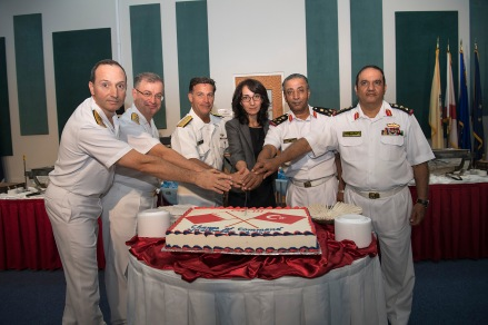 171102-N-XP344-094 MANAMA, Bahrain (Nov. 2, 2017) The official party of Combined Task Force (CTF) 151's change of command ceremony cut the ceremonial cake on Naval Support Activity Bahrain. CTF 151's mission is to disrupt piracy at sea and to engage with regional and other partners to build capacity and improve relevant capabilities in order to protect global maritime commerce and secure freedom of navigation. (U.S. Navy photo by Mass Communication Specialist 2nd Class Victoria Kinney/Released)