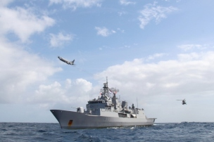 Te Kaha participating in Operation Haku. Flypast of Orion and Seasprite aircraft