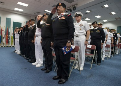 180301-N-XP344-012 MANAMA, Bahrain (March 1, 2018) Service members salute during the Kingdom of BahrainÕs national anthem in the multipurpose room aboard Naval Support Activity Bahrain during Combined Maritime ForcesÕ Combined Task Force (CTF) 151Õs change of command ceremony. CTF 151Õs area of operation includes some of the worldÕs busiest shipping lanes and spans over two million square miles, covering the Red Sea, Gulf of Aden, Indian Ocean and Gulf of Oman. (U.S. Navy photo by Mass Communication Specialist 2nd Class Victoria Kinney/Released)