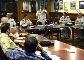 180314-N-PV215-0029 MANAMA, Bahrain (Mar. 14, 2018) Capt. Shane Cooper (center), force judge advocate, speaks to a legal working group as part of the Combined Maritime Forces (CMF) Maritime Security Conference. CMF is a unique multi-national collective of 32 like-minded nations, dedicated to promoting security and free flow of commerce across 3.2 million square miles of international waters in the Red Sea, Gulf of Aden, Somali Basin, the Indian Ocean and the Gulf. (U.S. Navy photo by Mass Communication Specialist 1st Class Bryan Neal Blair/Released)